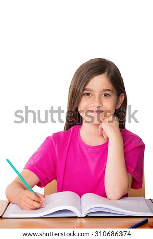 Cute pupil working at her desk against white background with vignette