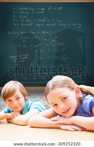 Cute pupils resting on their arms against teal, blue - stock photo