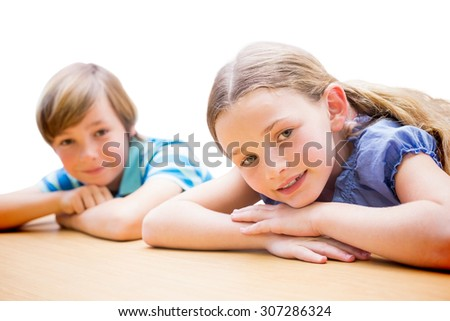 Cute pupils resting on their arms against white background with vignette