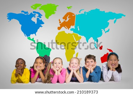 Cute pupils smiling at camera against grey vignette with world map