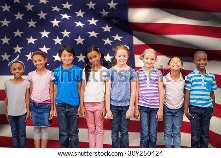 Cute pupils smiling at camera in classroom against digitally generated american national flag - stock photo