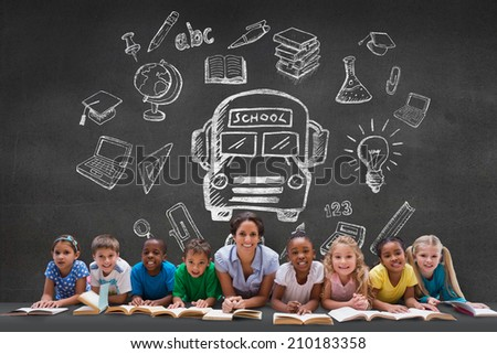 Cute pupils smiling at camera with teacher against black wall with school doodles - stock photo