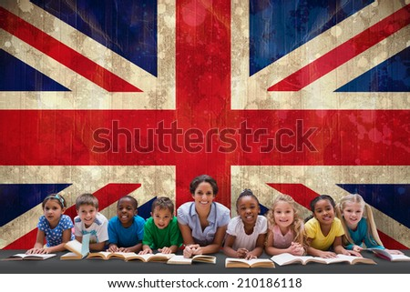 Cute pupils smiling at camera with teacher against usa flag in grunge effect - stock photo