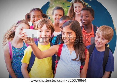 Cute pupils using mobile phone against white background with vignette - stock photo