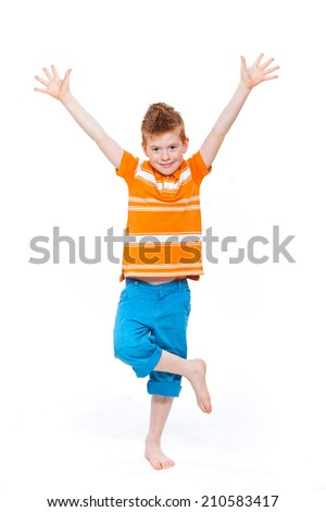 Cute red-haired boy against white background