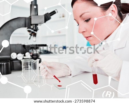 Cute redhaired female scientist doing an experiment in a lab against science formula - stock photo