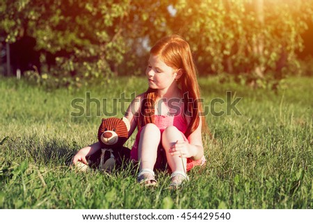 cute redhead girl with teddy bear. friendship concept - stock photo