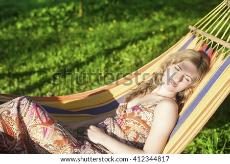Cute Relaxing Caucasian Lady Resting in Hummock and Dreaming Outdoors.Horizontal  Shot