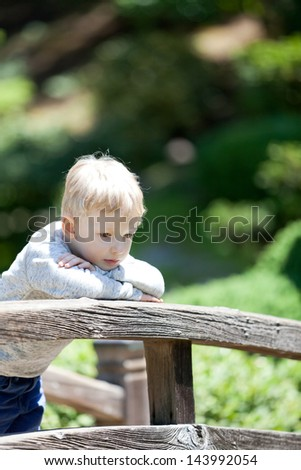 cute sad child outdoors - stock photo
