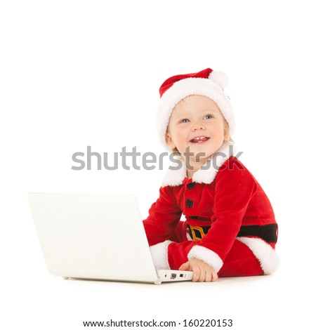 Cute santa baby with laptop on the white background