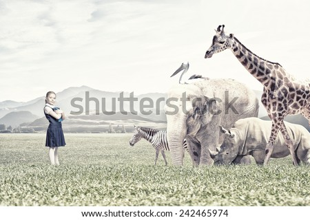 Cute school girl outdoor with wild animals - stock photo