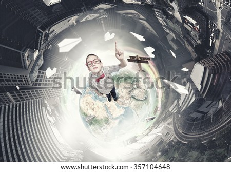 Cute schoolboy in red glasses with finger pointing up. Elements of this image are furnished by NASA