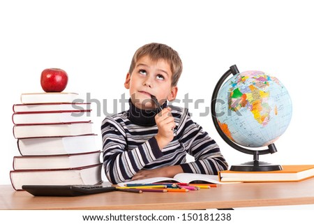 Cute schoolboy is thinking isolated on a white background - stock photo