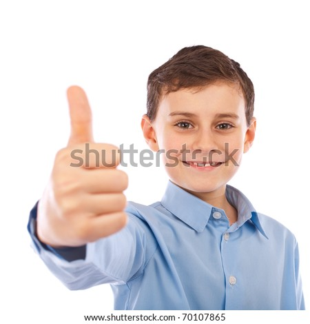 Cute schoolboy making thumbs up sign, isolated on white background - stock photo