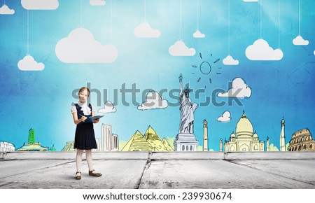 Cute schoolgirl against colorful background with folder in hands - stock photo