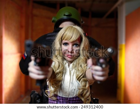cute schoolgirl aim guns and standing a back to the soldier - stock photo