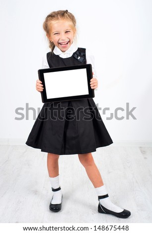 cute schoolgirl with a pc tablet on a white background - stock photo