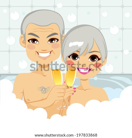 Cute senior couple enjoying relaxing bubble bath together making a toast with champagne - stock photo