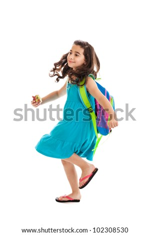 Cute seven year old mixed race school girl walking with apple isolated on white background - stock photo