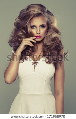 Cute sexy blond woman in studio - stock photo