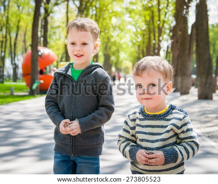 Cute siblings playing outdoors in park
