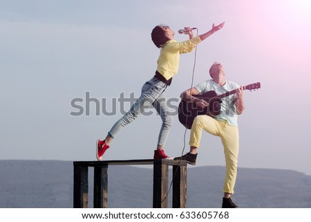 Cute Singer Woman Or Girl Singing On Table And Handsome Guitarist Man Playing Acoustic
