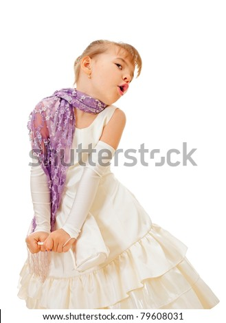 Cute singing little girl in cream dress isolated on a white background