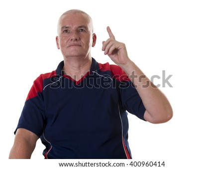 Cute single serious senior man wearing blue and red shirt with idea and pointing his finger upward over white background