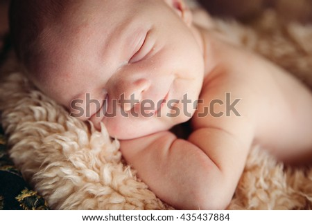 Cute Sleeping And Smiling Newborn Baby In A Wooden Basket On Wood Background. Close up