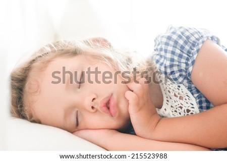 Cute sleeping baby girl - stock photo