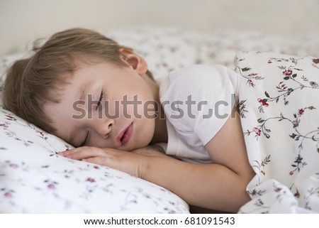 Cute sleeping baby in the morning light. Portrait with a copy space.
