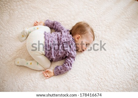 cute sleeping girl on bed - stock photo
