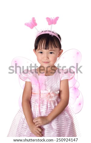 Cute small asian girl in fancy dress over white background.