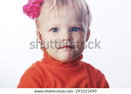 Cute small baby in red sweater