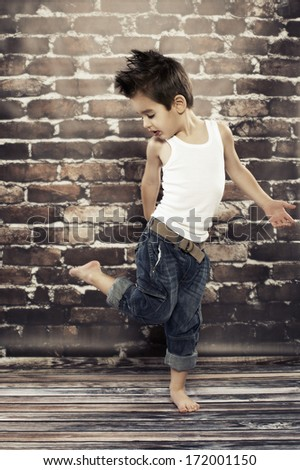 Cute small boy dance - stock photo