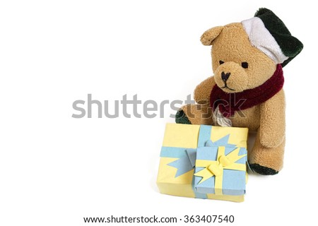 Cute small furry teddy bear toy sitting with two handmade paper gift boxes on isolated white background - background picture for wishing a happy birthday with birthday cards, or for valentines day - stock photo