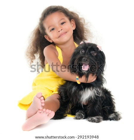 Cute small girl hugging her pet dog isolated on white - stock photo
