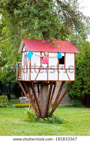 cute small tree house for kids on backyard girl inside