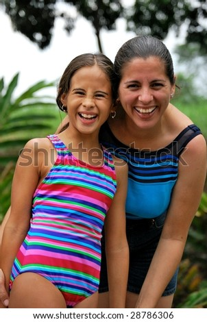 Cute smiles of a Hispanic mother and daughter