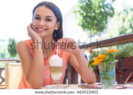 Cute smiley woman resting in cafe
