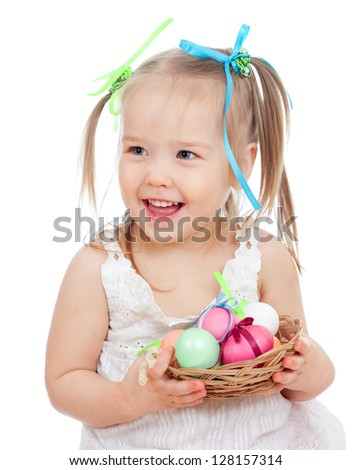 cute smiling baby girl holding Easter eggs in basket isolated on white background - stock photo