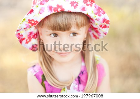 Cute smiling baby girl outdoors - stock photo