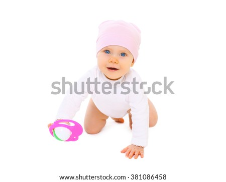 Cute smiling baby with toy crawls on a white background