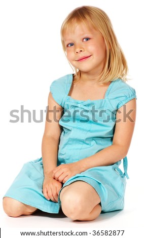 cute smiling blonde little girl sitting - stock photo