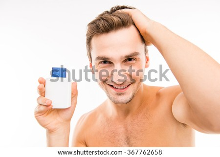 Cute smiling boy with perfume in front of the camera