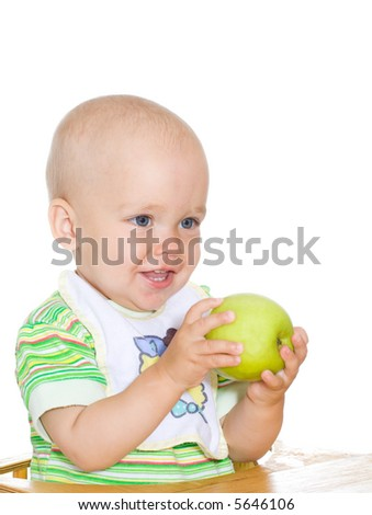 Cute smiling child holding green apple. Isolated. 2
