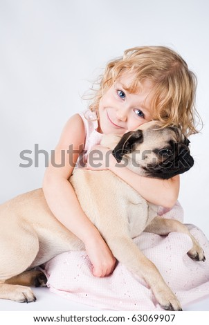 cute smiling girl embracing dog - stock photo