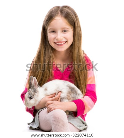 cute smiling girl in a crimson sweater  with baby rabbit over white background close-up - stock photo