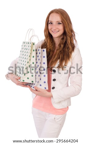 Cute smiling girl in light short coat with plastic bags isolated on white - stock photo
