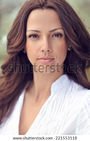 Cute smiling girl looking at you - stock photo